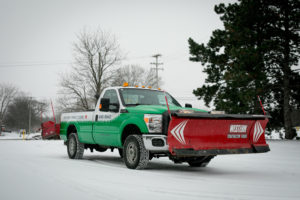 TLC truck with front end and rear end plows