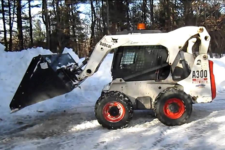 skid steer plowing snow