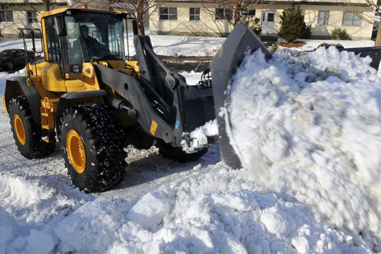 front end loader piling snow